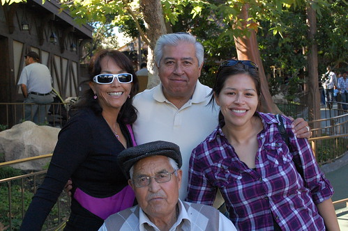 Cindy with her parents and grandfather