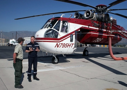 French firefighters learn from California visit. Capt. Philippe DelQuie talks with Helitanker Superintendent  Rocco Terracciano at the San Bernardino Air Tanker Base. USFS photo.