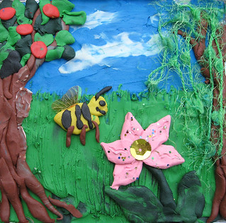 Plasticine forst with bumble bee and butterfly