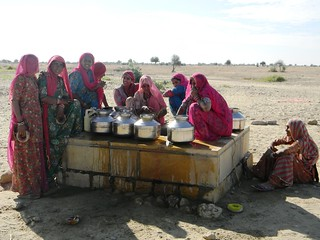 Rajasthani women drawing water from beris- wells that collect rainwater
