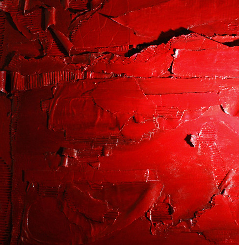 a detail of custom painting Ruby Horizon, Ruby Horizon, ruby red maroon crimson acrylic on cardboard sculptural bas-relief painting assemblage