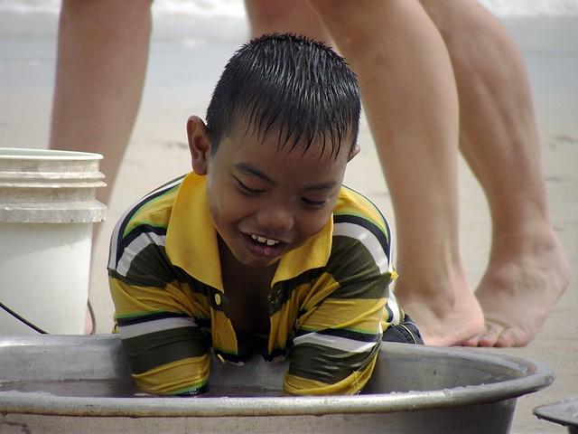 Boy Working on Beach