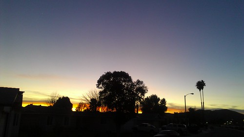 the sun setting in menifee after a denver broncos win by billgould