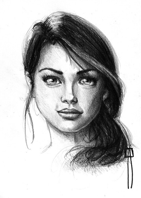female face drawing made with pencil.