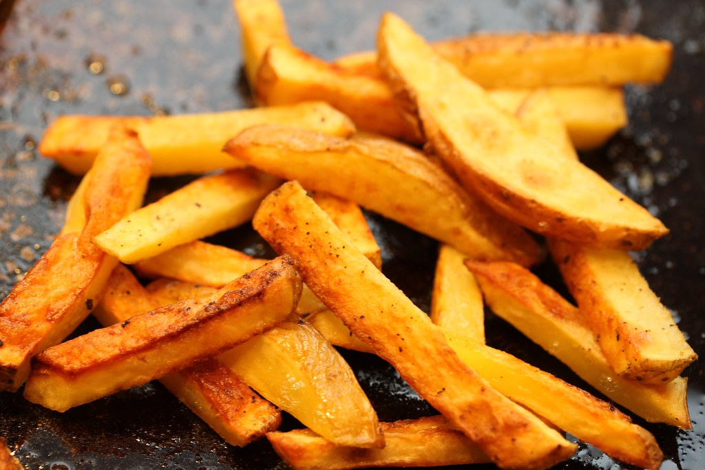 french fries all types, potato, salt added in processing, frozen, home-prepared, oven heated