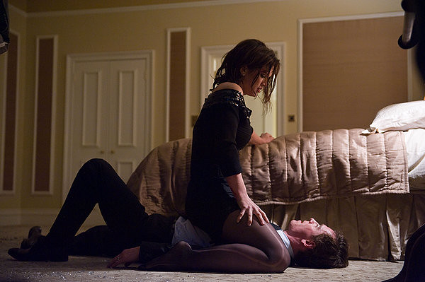 Gina Carano is about to give Michael Fassbender a surprise in HAYWIRE.