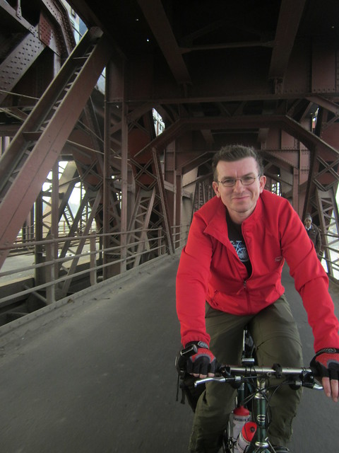 Jonathan cycling across the Old Iron Bridge, Delhi