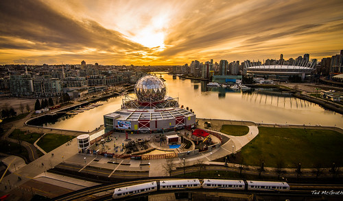 park sunset reflection water vancouver clouds tracks dome falsecreek skytrain vancouverbc scienceworld settingsun bcplace bcplacestadium telusworldofscience guideway vancouvercity eastfalsecreek inapark cans2s tedsphotos