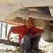 Reparando el mofle - Boy repairing the muffler; Tlaxiaco, Oaxaca, Mexico por Lon&Queta