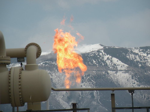 A flare burning released methane during natural gas drilling.