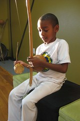Piaba learning to play the berimbau.