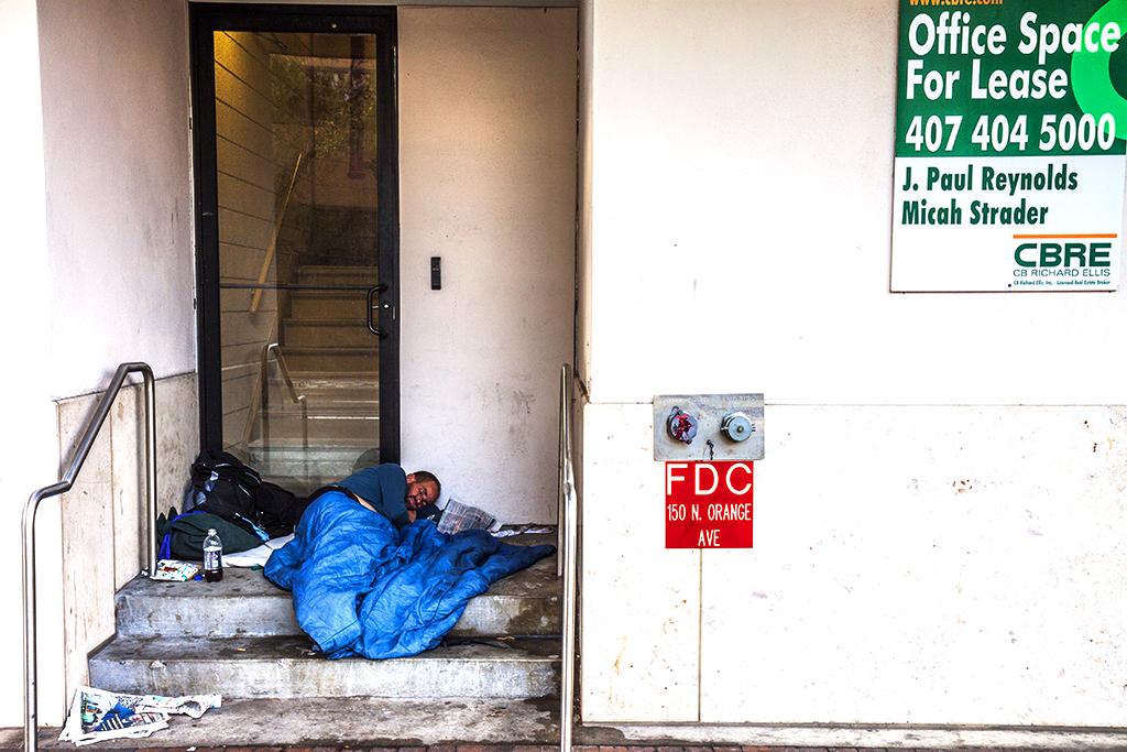Man-in-doorway-with-blue-comforter--Orlando-2
