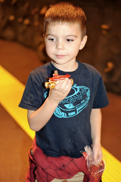 Angry Kid showing off his candy derby car.