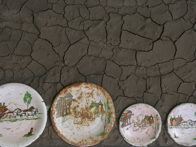 toy plates on dry, cracked mud