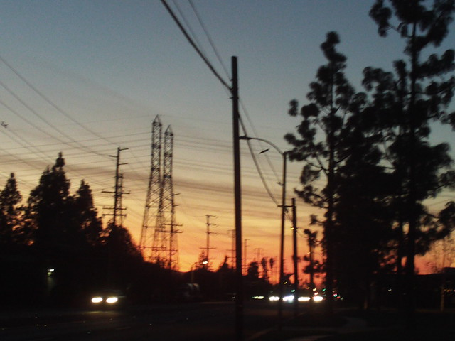 Sunset Silhoutte With Trees And Telephone Poles