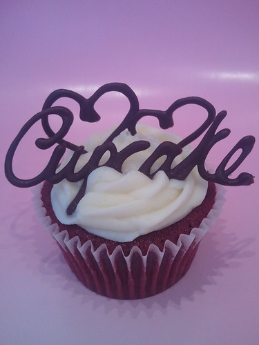 A Cupcake That Says Cupcake On Top In Chocolate Plus Beautiful