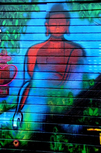 Painted Buddha in heart reaching mudra, vase of victory, red and blue, wall mural, Lama G's Cafe, Fremont, Seattle, Washington, USA by Wonderlane