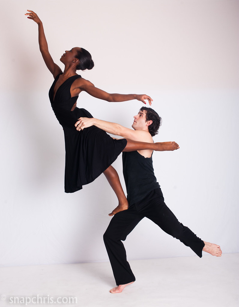 pretty ballet dance couple climbing to new heights a