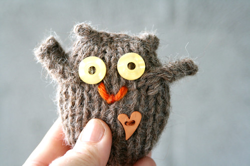 brown owl with thumb