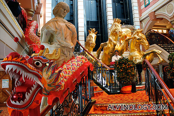 Chinese dragon and three golden horses