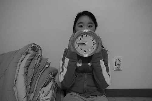 Girl With A Clock, Which is 5 minutes and 13 seconds Fast