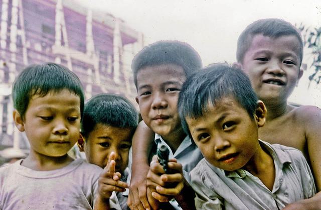 Young boys play on the street in My Tho, 1969 - Những chú bé vui chơi trên đường phố Mỹ Tho