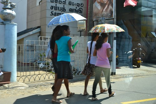 Umbrellas are used all day long: to protect from both the sun AND the sudden rain showers.