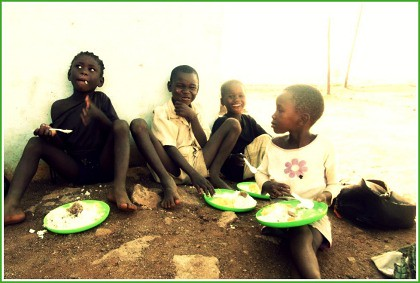 Swazi kids eating Cmeal framed Jenifer Peterson re-sized