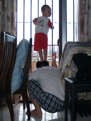 Justin standing on Daddy's head