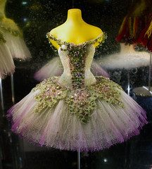 flower(0.0), gown(0.0), skirt(0.0), floristry(0.0), quinceaã±era(0.0), dance dress(1.0), dance skirt(1.0), clothing(1.0), purple(1.0), cocktail dress(1.0), ballet tutu(1.0), fashion(1.0), haute couture(1.0), pink(1.0), dress(1.0),