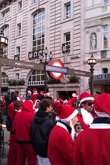 Santas at Piccadilly Circus Tube - Santacon 2011