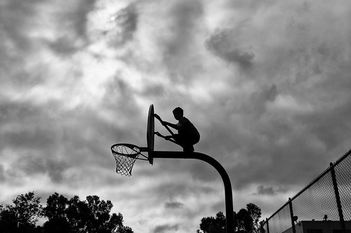 Boy on a Basketball Hoop