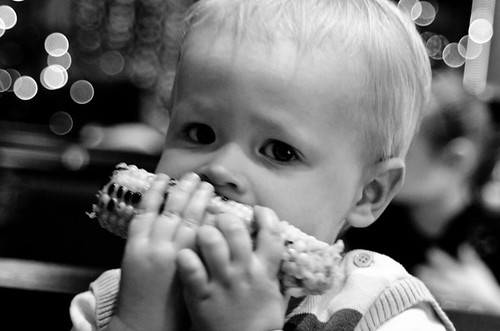 Nom! My son tucking in a cob of corn