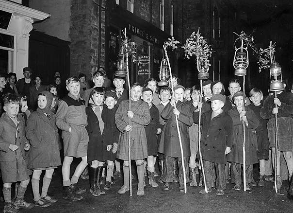 Boys with lanterns by Knighton Christmas tree