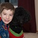 Small photo of A boy and his dog