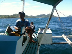 Boatmen fix a broken rudder