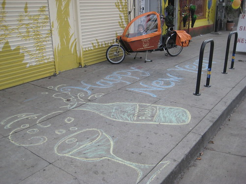 Happy New Year! chalk drawing in front of Flying Pigeon LA bike shop