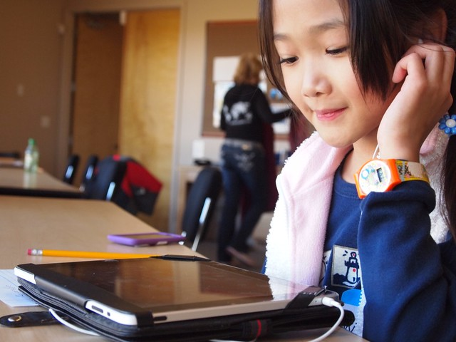 young girl learning with iPad
