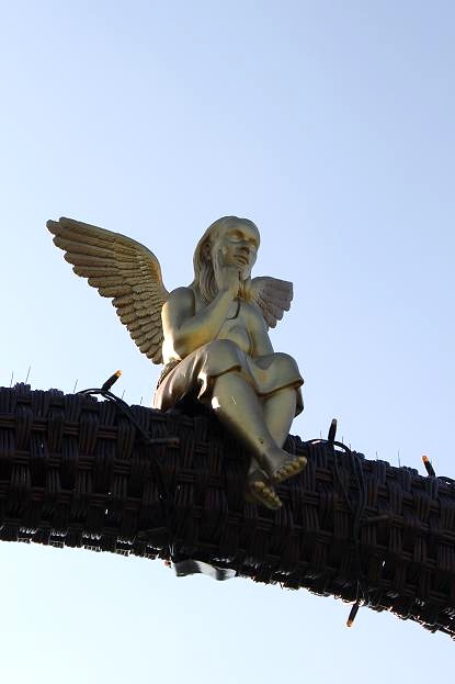 angel on huge basket