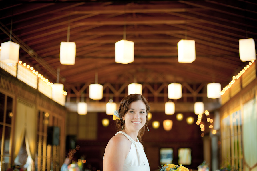 Bride inside the Apple House at Mt. Hood Organic farms with lanterns in background