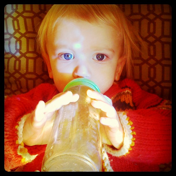 Some good habits start early - tea in her bottle.