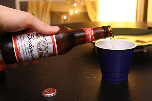 Pouring American Budweiser For Blind Tasting
