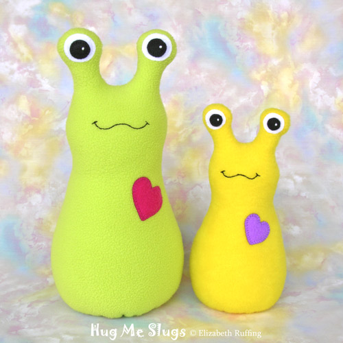 Bright light green and bright yellow Hug Me Slugs, original art toys by Elizabeth Ruffing