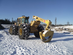snow removal(0.0), snowplow(0.0), snow blower(0.0), winter(1.0), vehicle(1.0), snow(1.0), off-roading(1.0), construction equipment(1.0), bulldozer(1.0),