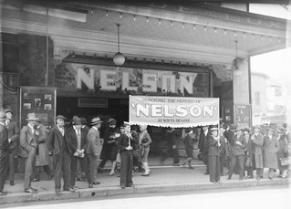"Naval League cadets in uniform march to Hoyts De Luxe Cinema, George Street, Sydney for the film ""Nelson"", 6 August 1928 / photographer Sam Hood"