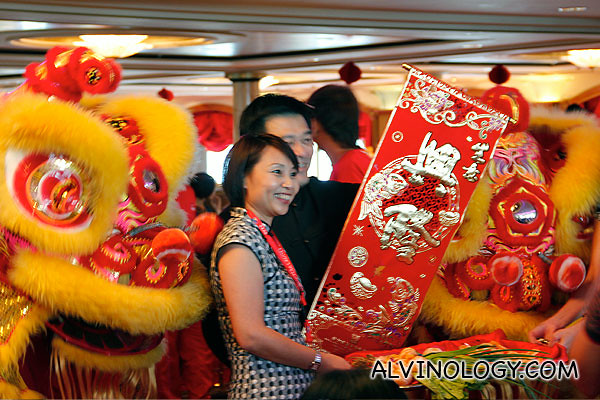 Two Star Cruises senior staff, Michael and Sandy unrolling a Chun Lian scroll