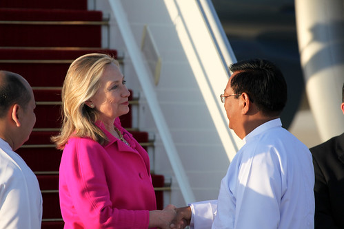Secretary of State Hillary Clinton is greeted by Burmese Deputy Foreign Minister Dr. Myo Myint as she arrives in Nay Pyi Taw to begin her historic visit to Burma. [State Department photo by Scott Weinhold]