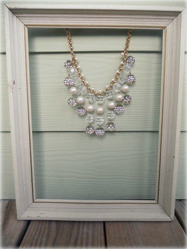 necklace in frame