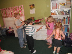 """All the cousins try to figure out what to play while waiting for """"dinner"""" to be ready."""