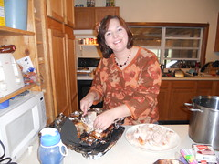 Mandy prepares the turkey for dinner.
